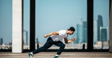man-in-white-t-shirt-and-black-pants-in-a-running-position